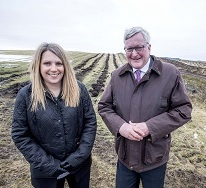 Hannah Blythyn, Welsh Minister for Environment standing in front of Scottish tree nursery.