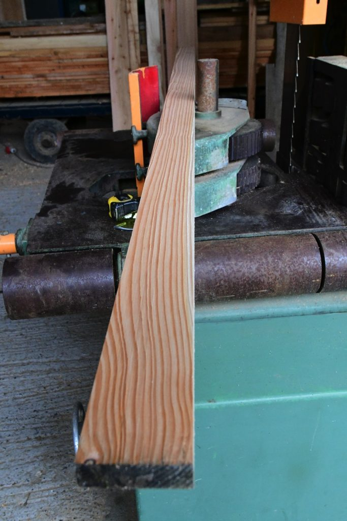 Larch on planer showing straightness of the grain