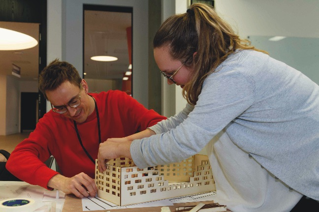 Students constructing a timber model